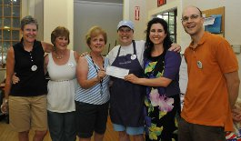 Presentation of the Willis Foundation Check: Mary Moriarty (TOPIC Secretary),  Merri Serra (TOPIC Board), Maureen McKeown (TOPIC President), Ellen  Spero (Cook and Pastor of First Parish UU Church) , Ami Hughes (Willis Associate) and Craig Bonaceto (TOPIC Board)