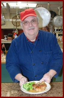 One of our cooks, Paul Windt, with the ever popular, Cranberry Orange Chicken
